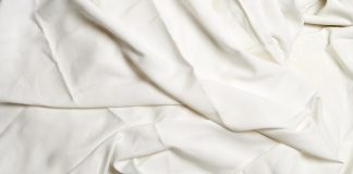 Textured white crumpled sheets